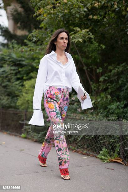 A guest is seen attending Sacai during Paris Fashion Week wearing Sacai on October 2 2017 in Paris France