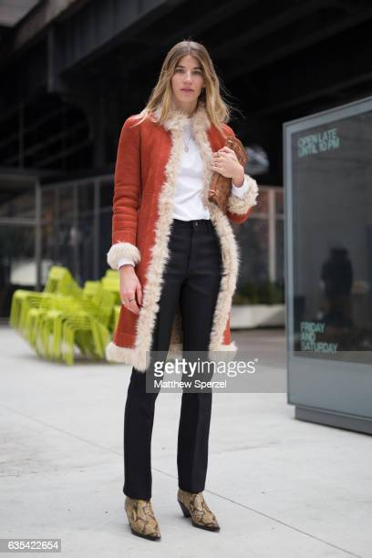 A guest is seen attending Tory Burch during New York Fashion Week wearing a rust fur lined coat on February 14 2017 in New York City