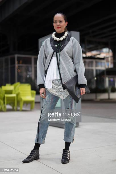A guest is seen attending Tory Burch during New York Fashion Week wearing a mesh coat with oversized pearl necklace on February 14 2017 in New York...