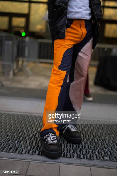 A guest is seen attending VFILES during New York Fashion Week wearing orange and navy patchwork pants on September 6 2017 in New York City