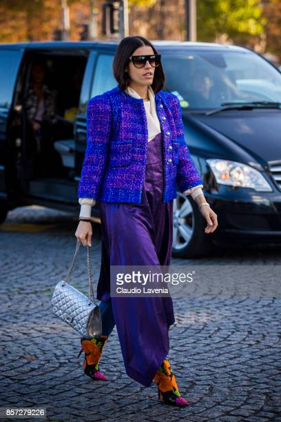A guest is seen before the Chanel show during Paris Fashion Week Womenswear SS18 on October 3 2017 in Paris France