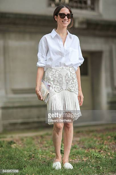 A guest is seen before the Giambattista Valli show during Paris Fashion Week Haute Couture F/W 2016/2017 on July 4 2016 in Paris France