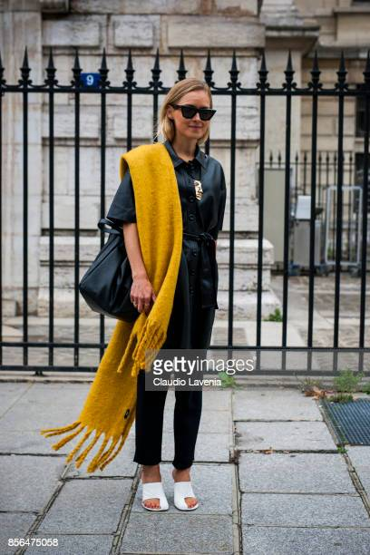 A guest is seen before the Givenchy show during Paris Fashion Week Womenswear SS18 on October 1 2017 in Paris France