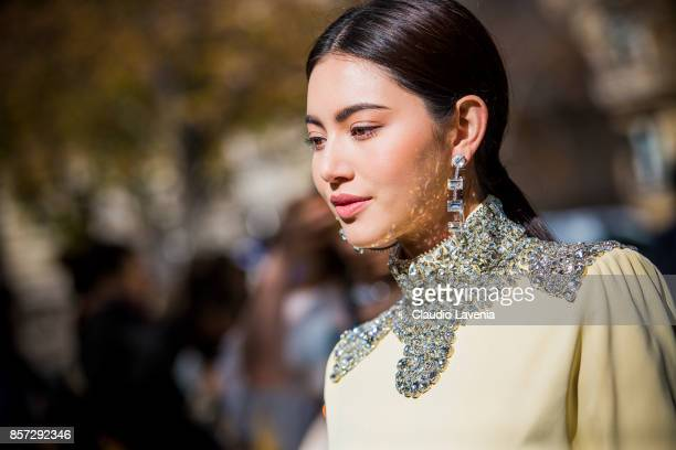 A guest is seen before the Miu Miu show during Paris Fashion Week Womenswear SS18 on October 3 2017 in Paris France