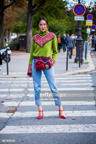 A guest is seen before the Moncler Gamme Rouge show during Paris Fashion Week Womenswear SS18 on October 3 2017 in Paris France