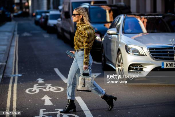 Guest is seen checked yellow top with strong shoulder line, denim jeans, transparent bag, black ankle boots outside Edward Crutchley during London...