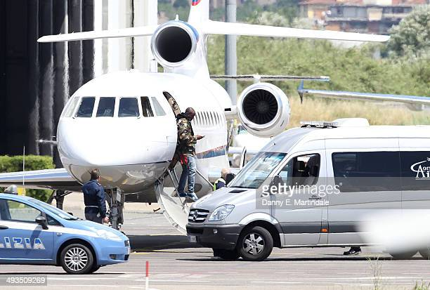 A guest is seen getting off a private jet before the Kanye West wedding to Kim Kardashian on May 24 2014 in Florence Italy