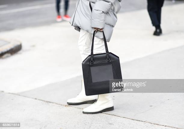 A guest is seen holding a black bag outside of the STAMPD show during New York Fashion Week Men's AW17 on February 2 2017 in New York City