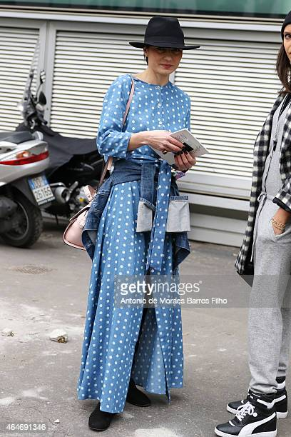 Guest is seen in the streets of Milan during Milan Fashion Week 2015 on February 25, 2015 in Milan, Italy.