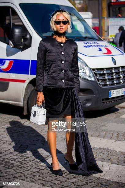 A guest is seen in the streets of Paris after the Chanel show during Paris Fashion Week Womenswear SS18 on October 3 2017 in Paris France