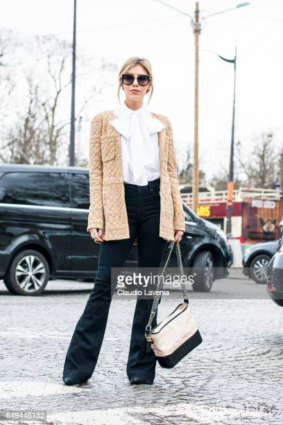 A guest is seen in the streets of Paris before the Chanel show during Paris Fashion Week Womenswear Fall/Winter 2017/2018 on March 7 2017 in Paris...
