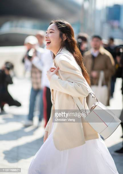 A guest is seen laughing at the Hera Seoul Fashion Week 2019 F/W at Dongdaemun Design Plaza at Dongdaemun Design Plaza on March 23 2019 in Seoul...