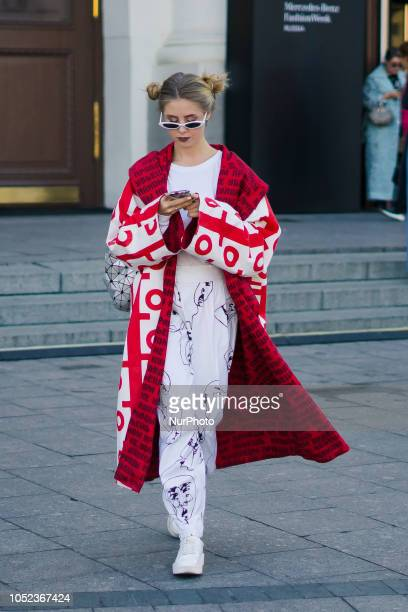 A guest is seen on street during the Mercedes Benz Fashion Week Russia Spring/Summer 2019 day five on October 16 2018 in Moscow Russia