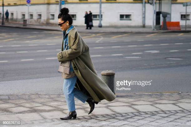 A guest is seen on street during the Mercedes Benz Fashion Week Russia Fall/Winter 2018/19 on March 11 2018 in Moscow Russia