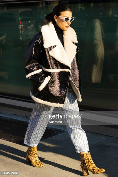 Guest is seen on the set of the Armani Advertising Campaign street style during Milan Men's Fashion Week Fall/Winter 2018/19 on January 13 2018 in...