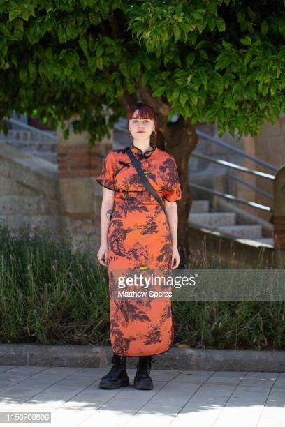 A guest is seen on the street attending 080 Barcelona Fashion Week wearing a silk orange nature print dress and black combat boots on June 27 2019 in...