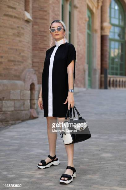 A guest is seen on the street attending 080 Barcelona Fashion week wearing black/white dress and bag with black sandals on June 25 2019 in Barcelona...