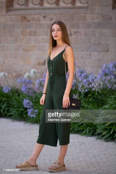 A guest is seen on the street attending 080 Barcelona Fashion Week wearing dark green dress with Birkenstock sandals and black bag on June 26 2019 in...
