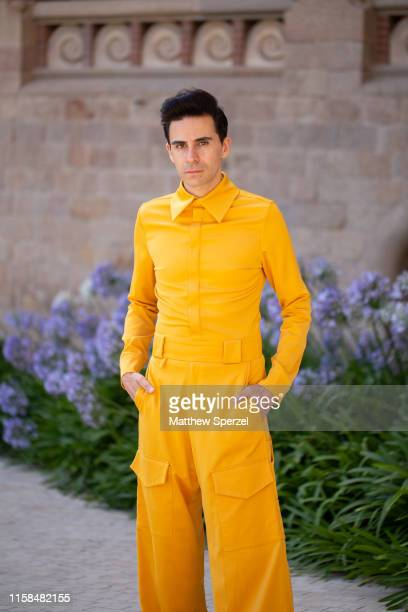 A guest is seen on the street attending 080 Barcelona Fashion Week wearing yellow jumpsuit on June 26 2019 in Barcelona Spain