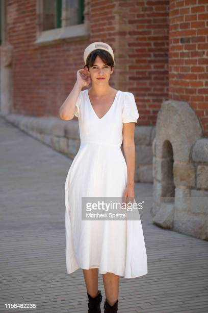 A guest is seen on the street attending 080 Barcelona Fashion Week wearing white dress with white hat on June 26 2019 in Barcelona Spain