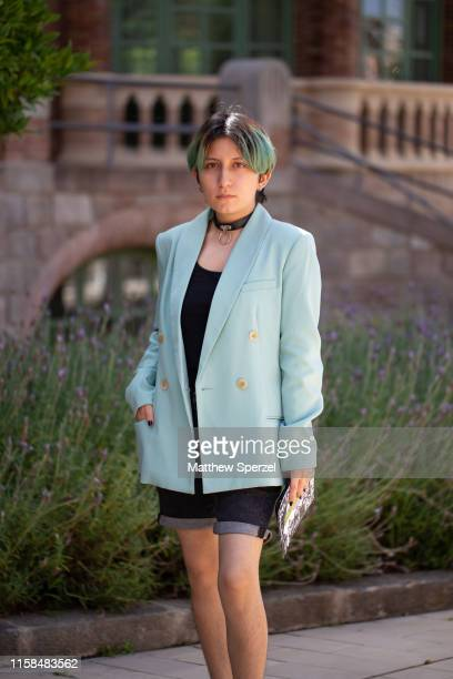 Guest is seen on the street attending 080 Barcelona Fashion Week wearing baby blue blazer, black shirt and shorts, choker on June 26, 2019 in...
