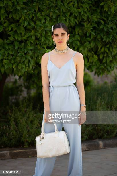 A guest is seen on the street attending 080 Barcelona Fashion Week wearing baby blue spaghetti strap dress with silver jewelry and white bag on June...