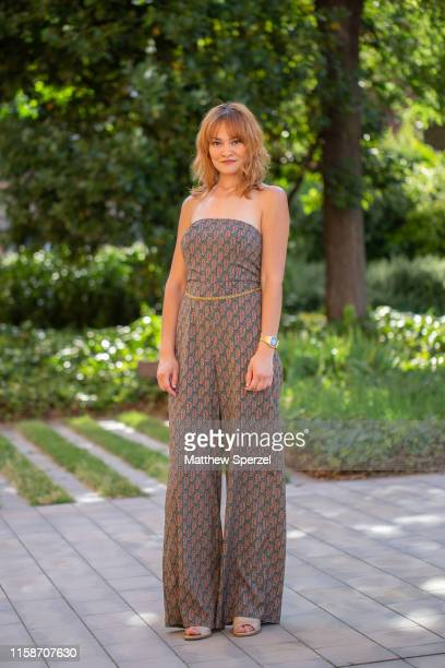 A guest is seen on the street attending 080 Barcelona Fashion Week wearing brown pattern jumpsuit with gold belt on June 27 2019 in Barcelona Spain