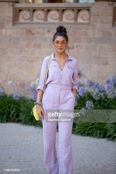 A guest is seen on the street attending 080 Barcelona Fashion Week wearing lavender jumpsuit with yellow bag and sunglasses on June 27 2019 in...