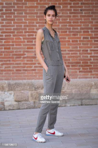 A guest is seen on the street attending 080 Barcelona Fashion Week wearing grey sleeveless jumpsuit with Nike sneakers on June 27 2019 in Barcelona...