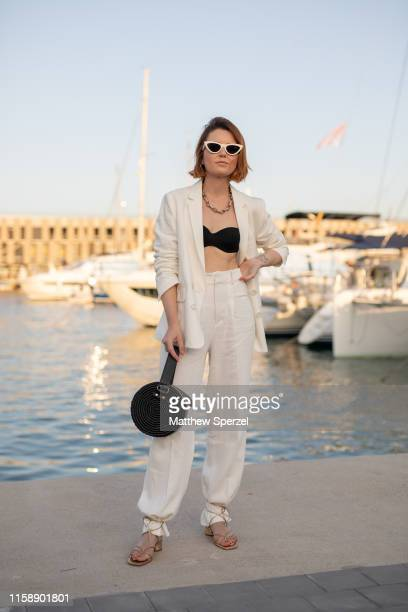 A guest is seen on the street attending 080 Barcelona Fashion Week wearing linen white blazer and pants with black bag and sunglas on June 28 2019 in...
