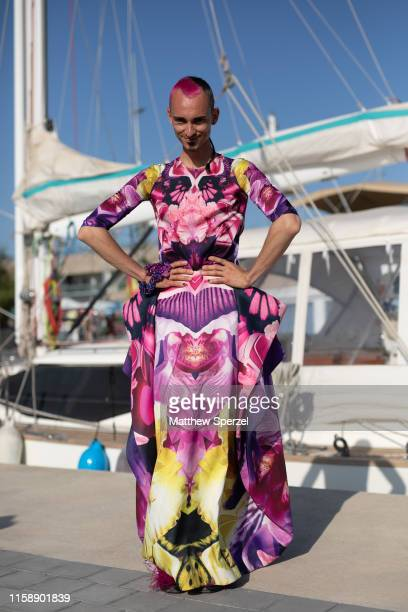 A guest is seen on the street attending 080 Barcelona Fashion Week wearing pink/purple dress on June 28 2019 in Barcelona Spain