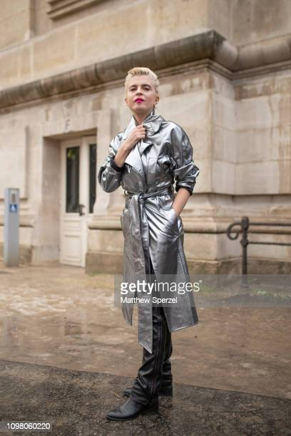 Guest is seen on the street attending ALEXANDRE VAUTHIER during Paris Haute Couture Fashion Week wearing silver metallic coat with black shoes on...