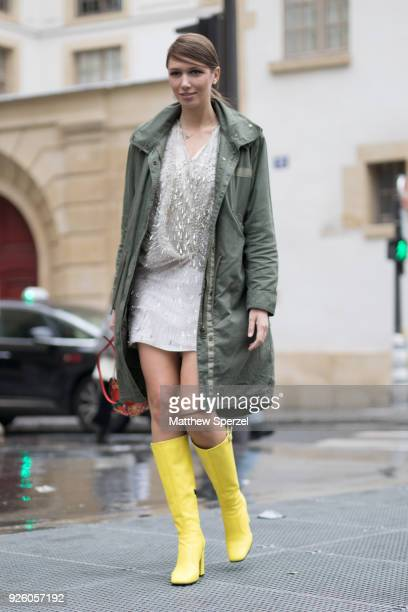 A guest is seen on the street attending Ann Demeulemeester during Paris Fashion Week Women's A/W 2018 Collection wearing an army green coat with...