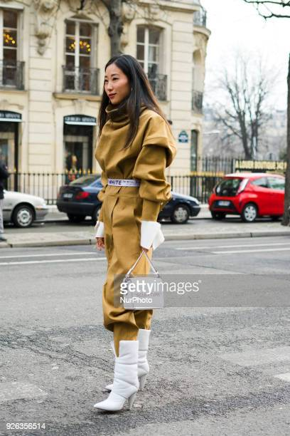 A guest is seen on the street attending Ann Demeulemeester during Paris Fashion Week Women's A/W 2018 Collection wearing Off White on March 1 2018 in...
