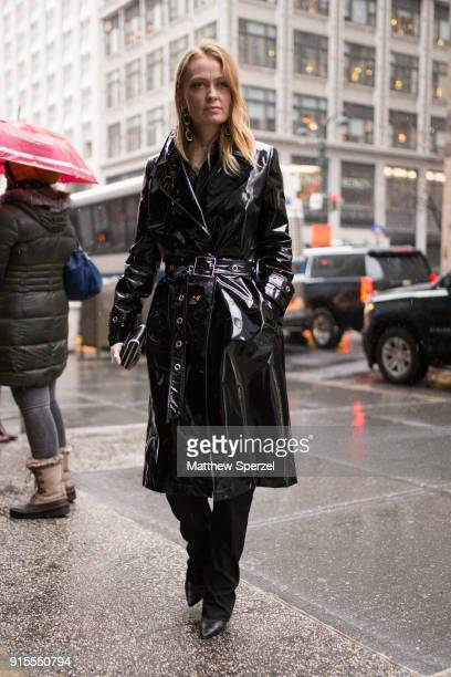 A guest is seen on the street attending BOSS during New York Fashion Week Men's wearing a black vinyl raincoat on February 7 2018 in New York City