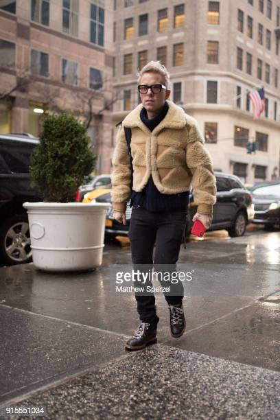 A guest is seen on the street attending BOSS during New York Fashion Week Men's wearing a tan lambwool coat on February 7 2018 in New York City