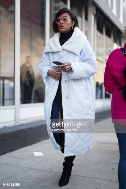 A guest is seen on the street attending Colovos and Noon By Noor during New York Fashion Week wearing a babyblue down parka on February 8 2018 in New...