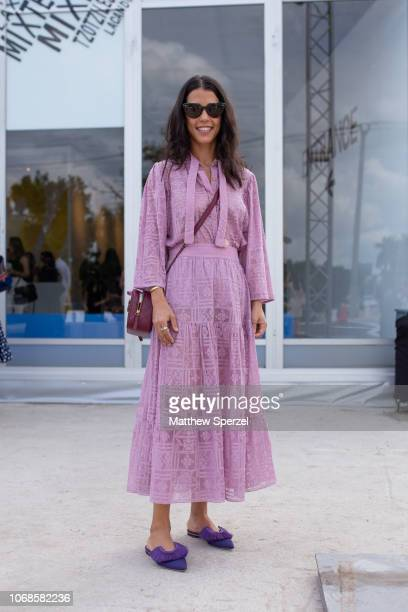 A guest is seen on the street attending Design Miami Preview Day during Miami Art Week wearing purple dress with purple Chanel bag and purple fringe...