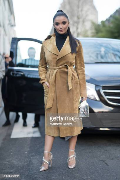 A guest is seen on the street attending Herms during Paris Women's Fashion Week A/W 2018 wearing Herms on March 3 2018 in Paris France