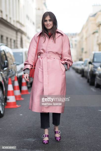 A guest is seen on the street attending Herms during Paris Women's Fashion Week A/W 2018 wearing a pink coat with purple shoes on March 3 2018 in...