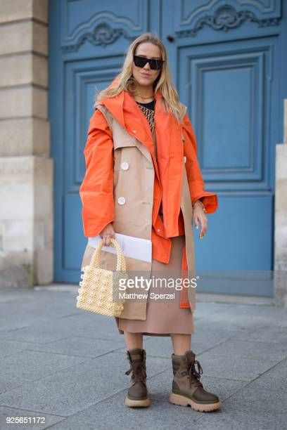 A guest is seen on the street attending Lanvin during Paris Fashion Week Women's A/W 2018 Collection wearing an orange/camel coat on February 28 2018...