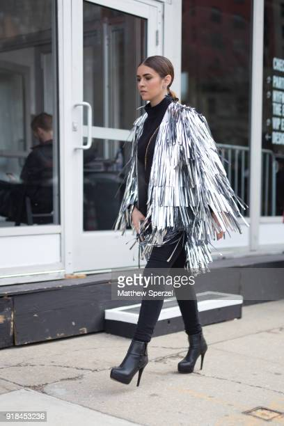 A guest is seen on the street attending Leanne Marshall during New York Fashion Week wearing a silver fringe jacket on February 14 2018 in New York...