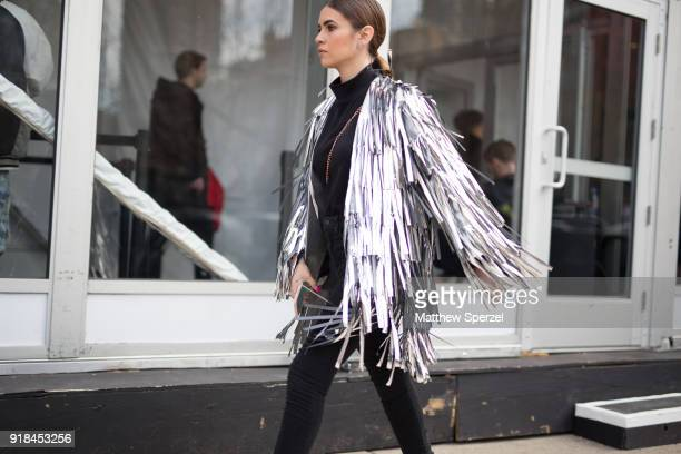 Guest is seen on the street attending Leanne Marshall during New York Fashion Week wearing a silver fringe jacket on February 14, 2018 in New York...