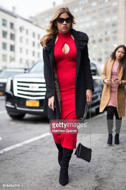 A guest is seen on the street attending Leanne Marshall during New York Fashion Week wearing a red dress with black coat on February 14 2018 in New...