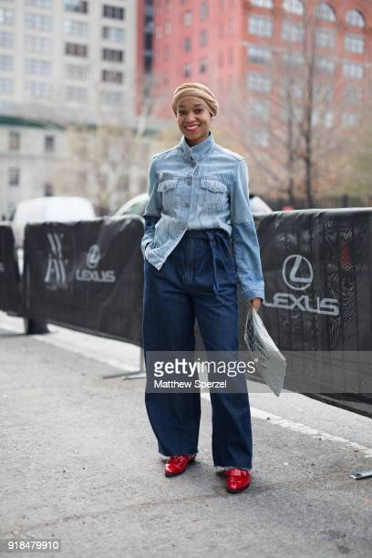 A guest is seen on the street attending Leanne Marshall during New York Fashion Week wearing a blue denim shirt with navy pants on February 14 2018...