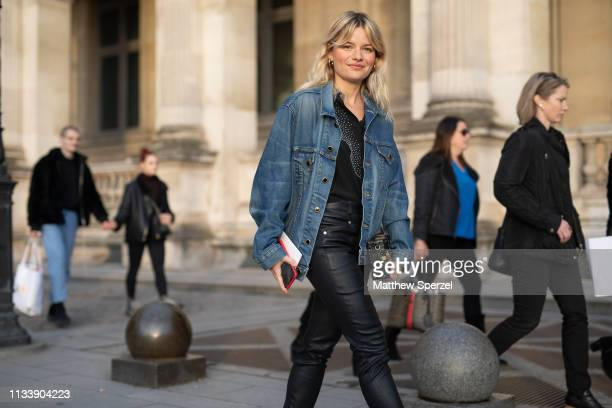 A guest is seen on the street attending LOUIS VUITTON during Paris Fashion Week AW19 wearing denim jacket with black jeans on March 05 2019 in Paris...