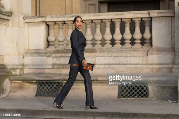 A guest is seen on the street attending LOUIS VUITTON during Paris Fashion Week AW19 wearing LOUIS VUITTON on March 05 2019 in Paris France