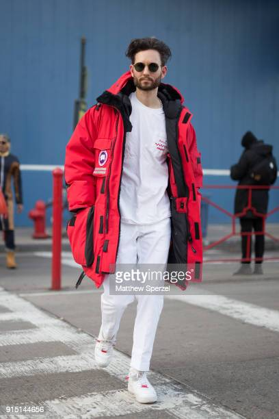 A guest is seen on the street attending LUAR and Death To Tennis during New York Fashion Week Men's wearing a red parka on February 6 2018 in New...