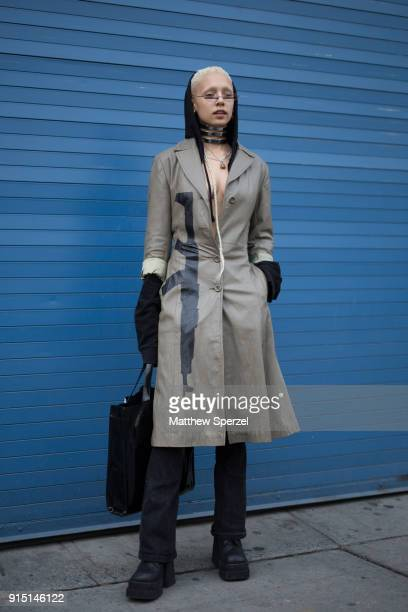 A guest is seen on the street attending LUAR and Death To Tennis during New York Fashion Week Men's wearing a gunprint trench coat on February 6 2018...