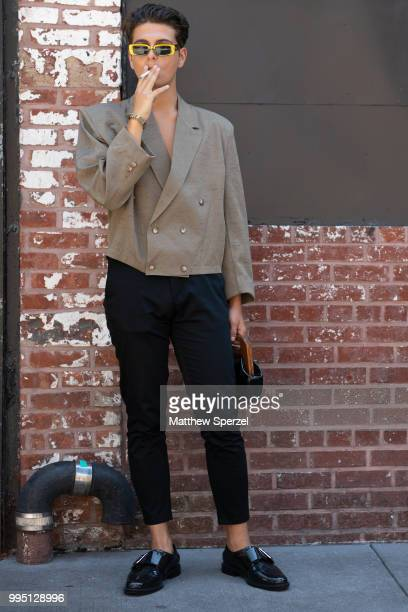 A guest is seen on the street attending Men's New York Fashion Week wearing a taupe blazer with black pants on July 9 2018 in New York City